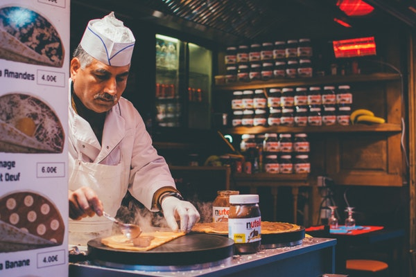 a man in a crepe food truck