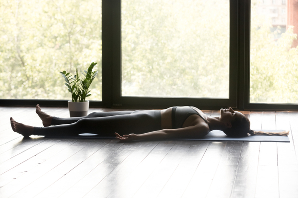The corpse pose is restorative and helps with relaxation and breathing.