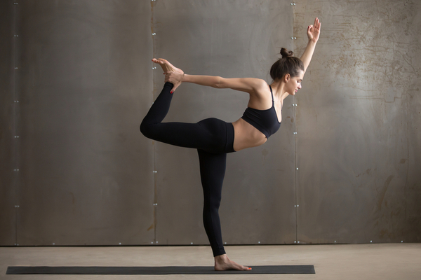 Dancer Pose promotes balance and helps alleviate stress and anxiety.