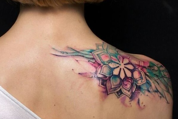 Trendy floral watercolor tattoo